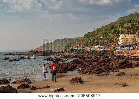 The Man And Woman Walking On Arambol Beach