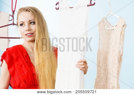 Happy Smiling Woman Next To Short White Dress