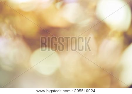 Blur background of gold color bokeh light Popular in the general festival. Make the luxury image in your work piece.