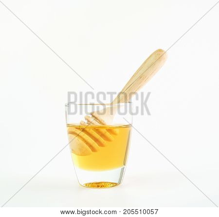 Honey in a glass put on white background