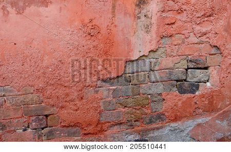 Surface of the crack brick wall with red ciement Stone texture and background.