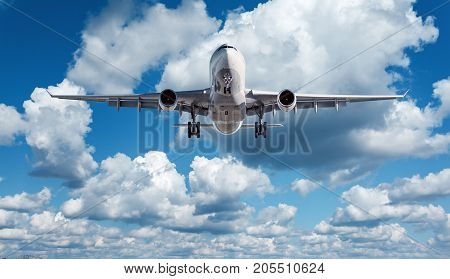 White Passenger Airplane Is Flying In The Blue Sky With Clouds