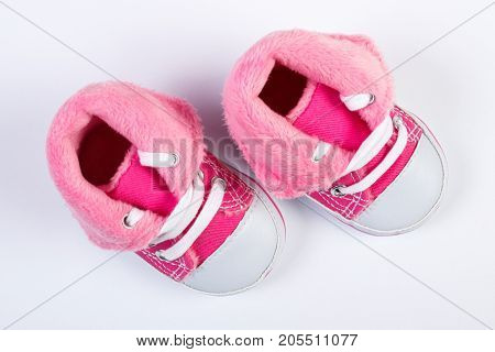 Pair Of Baby Shoes On White Background, Expecting For Newborn Concept