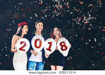 Newyear Party ,celebration Party Group Of Asian Young People Holding Balloon Numbers 2018 Happy And