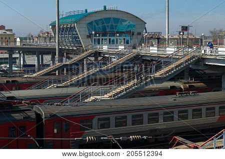 Novosibirsk, Russia - April 11, 2017: Trains on the railway tracks of the station in the city of Novosibirsk