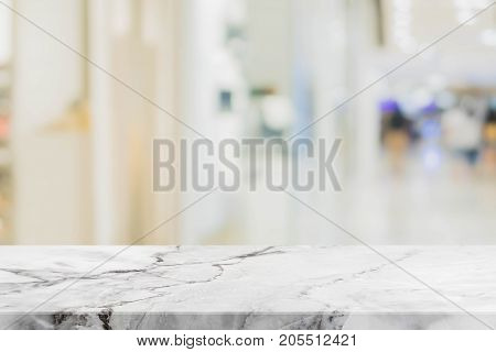 Stone table top on blurred with bokeh shopping mall background - can be used for display or montage your products