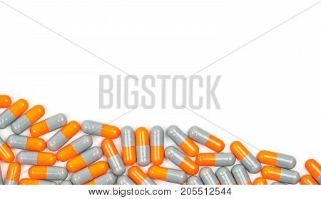 Colorful of antibiotic capsules pills isolated on white background with copy space. Drug resistance antibiotic drug use with reasonable health policy and health insurance concept.