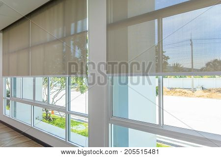 Roll Blinds on the windows the sun does not penetrate the house. Window in the Interior Roller Blinds. Beautiful Blinds on the Window the Sun and Heat Protection the Perfect Windows Interior Decor