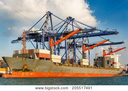 Shipping port and logistics terminal at daylight. Sea freight Business transportation.