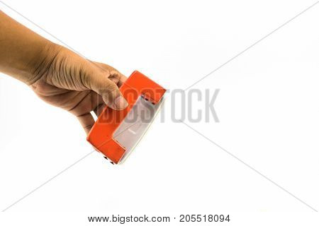 An Orange Paper Punch On The Hand Of Man Isolated