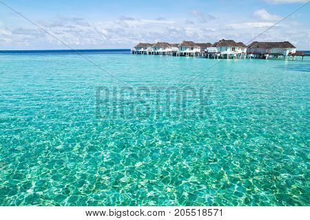 Beautiful beach landscape with over water bungalow at Maldives