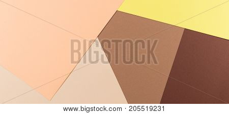 Abstract colored paper banner backgroud. Pastel brown, beige and yellow paper background.