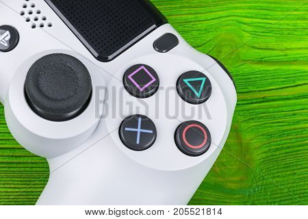 Sankt-Petersburg Russia September 24 2017: Sony PlayStation 4 game console with a joystick dualshock 4 on Green background home video game console