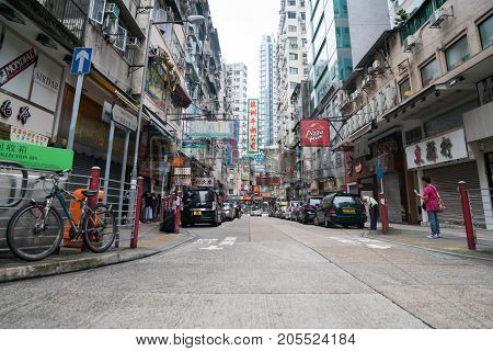 HONG KONG ASIA - AUGUST 2 2017; Street scene typically Asian with high buildings along both sides and plethora neon signs in Hong Kong
