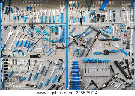 Stand With Set Tools On Bicycle Workshop