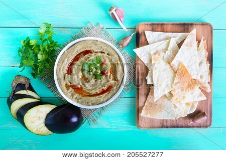 Baba ganush - hummus from eggplant with seasoning parsley. Eastern cuisine.