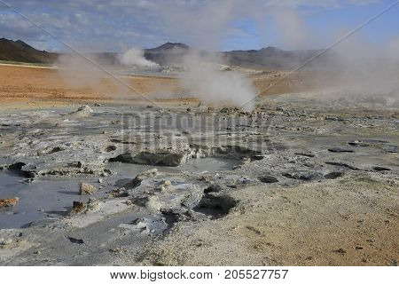 Fumaroles volcanic boiling mud pots surrounded by sulfur hot springs in Hverir Namafjall geothermal place in Iceland
