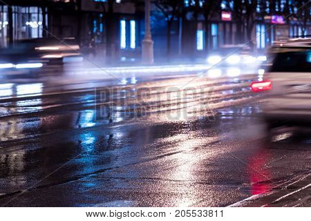 Cars In Blurred Motion At Night With Switched On Headlights
