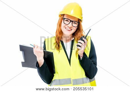 A Young Woman Foreman With Glasses And A Yellow Helmet With A Walkie-talkie Isolated