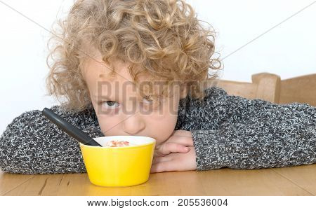 little blond boy does not want to eat