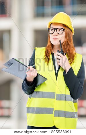 Portrait Of A Brigadier Woman With A Walkie-talkie On A Construction Site