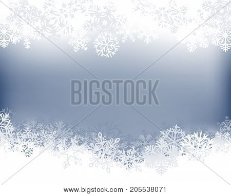 Winter background. White border made of fluffy snowflakes with space for text on soft blue background .