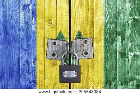 Saint Vincent and the Grenadines flag on door with padlock