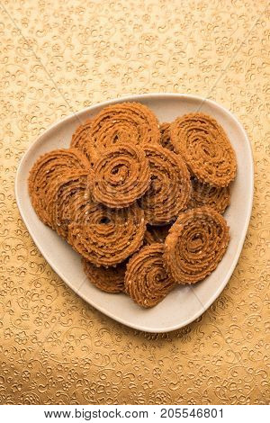 Stock Photo of Chakli or Chakali or Murukku, popular salty food made during diwali festival