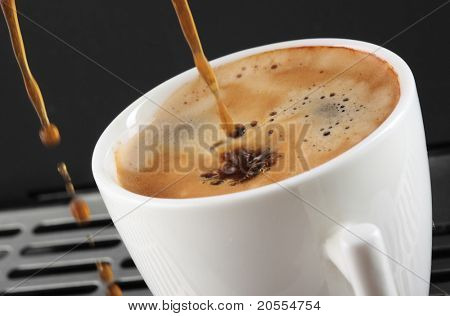coffee expresso being poured into a mug- blurry movement-
