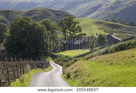Quiet lane near Ullswater the Lake District Cumbria England.
