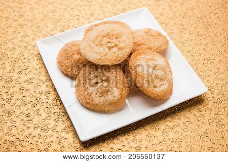 Stock Photo of Anarsa which is an authentic Maharashtrian sweet pastry-like dish especially made in the festive season in Maharashtra and Bihar, selective focus