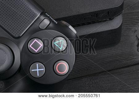 Sankt-Petersburg Russia September 24 2017: Sony PlayStation 4 Slim 1Tb revision and dualshock game controller. Game console with a joystick. Home video game console
