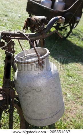 Detail Of An Old Bicycle With Aluminum Milk Canister