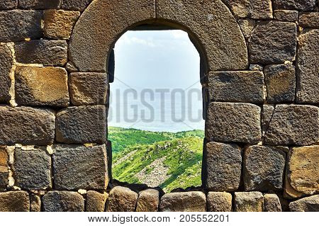 View through the window in brick wall of the medieval armenian fortress Amberd