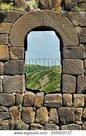 Window in brick wall of the medieval armenian fortress Amberd