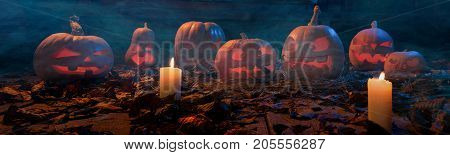 The Concept Of Halloween. A Lot Of Luminous Evil Terrible Pumpkins, Jack-lantern, With Candles, Leav