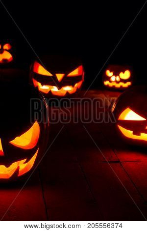 The Concept Of Halloween. Many Glowing Fiery Light Angry Scary Pumpkins. Jack Lantern In The Dark, O