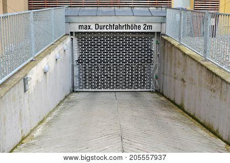 closed gateway of a subterranean garage, concrete