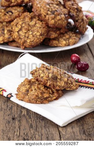 Applesauce oatmeal cookies with dried cranberries on wooden table