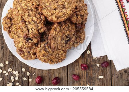 Applesauce oatmeal cookies with dried cranberries. Top view.