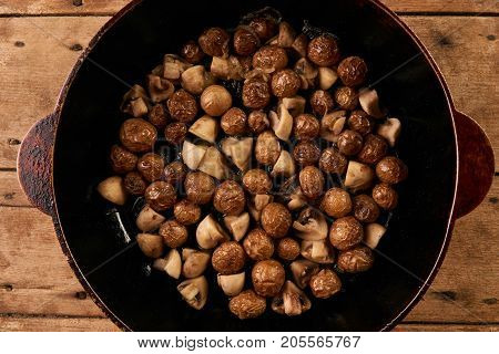 Fried Potatoes And Mushrooms In Frying Pan