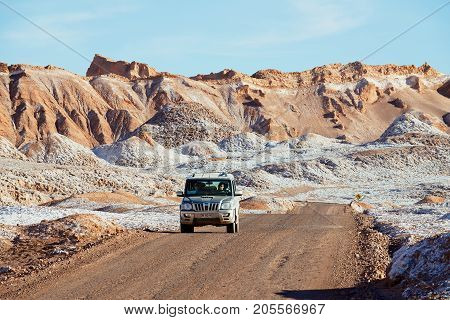 SAN PEDRO DE ATACAMA, CHILE - NOVEMBER 24, 2013: Unidentified people drive car in Valle de la Luna in San Pedro de Atacama, Chile.