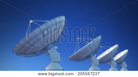 Array Of Satellite Dishes Or Radio Antennas Against Blue Sky. 3D