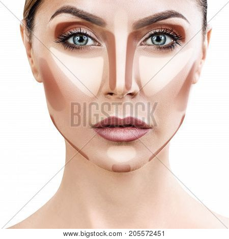 Young woman with sample contouring and highlight makeup on face. Over white background.