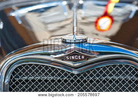 San Pellegrino Terme, Italy - July 16, 2017: Vintage Classic Car Show - Closeup On Singer Icon Of An