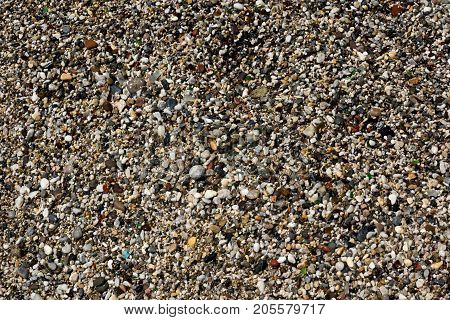 Abstract background with pebbles. Round sea multicolored stones. Small pebbles.