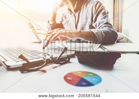 Young Accountant Hand Holding Smartphone To Call Marketing Consultants And Using Laptop Computer To