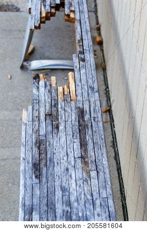 a broken bench sitting outside lost and forgotten