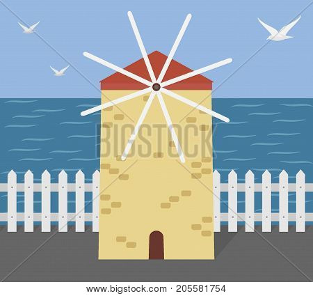 Old Greek Windmill On The Seashore. Marine Landscape With A Windmill, A White Fence, The Sea And Sea
