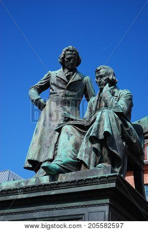Statue of the Grimm Brothers, looking down, City of Hanau - Germany; vertical format